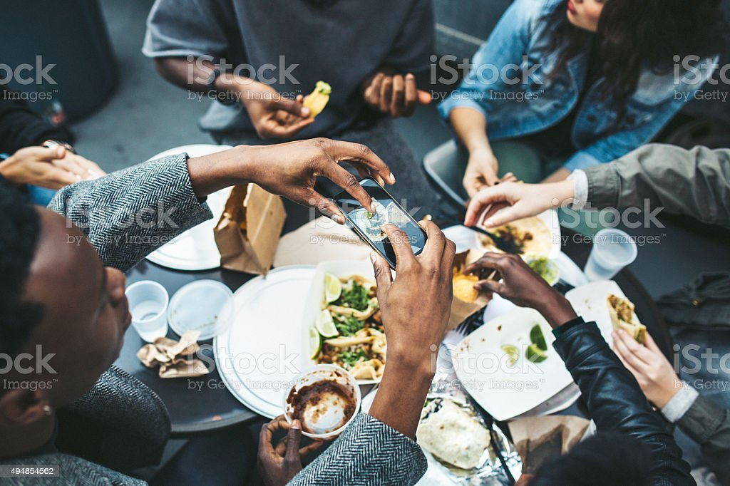 Friends in New York at Food Cart royalty-free stock photo