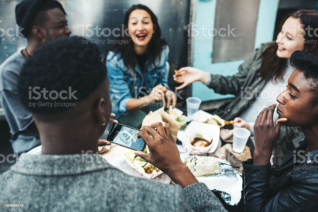 Friends in New York at Food Cart stock photo