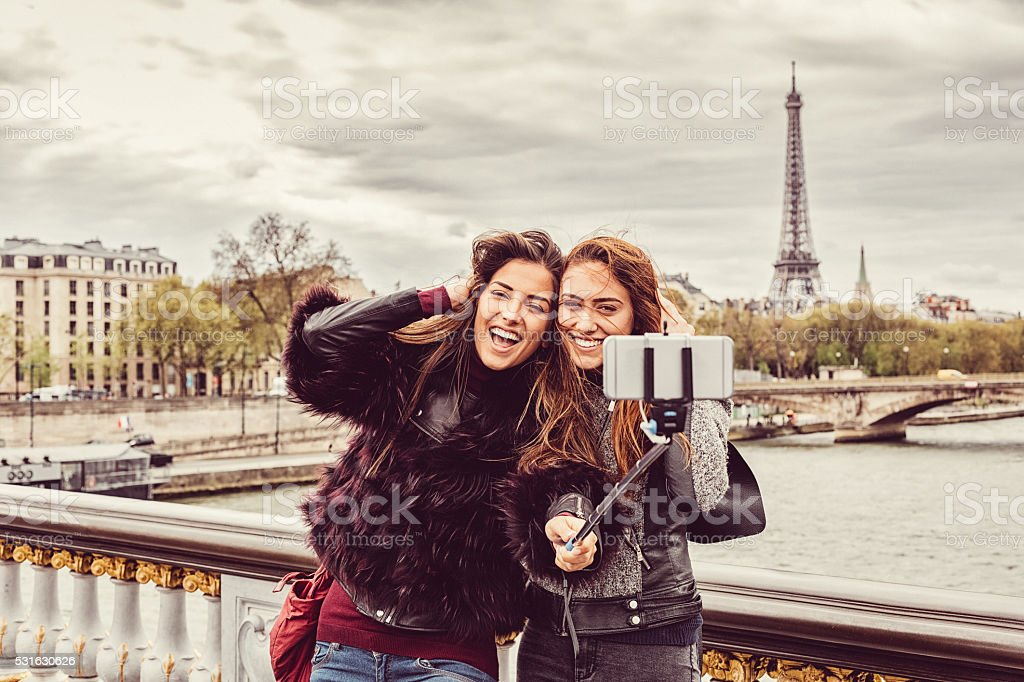 Friends in Paris taking selfie stock photo