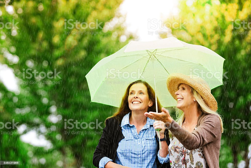 Friends in Rain stock photo