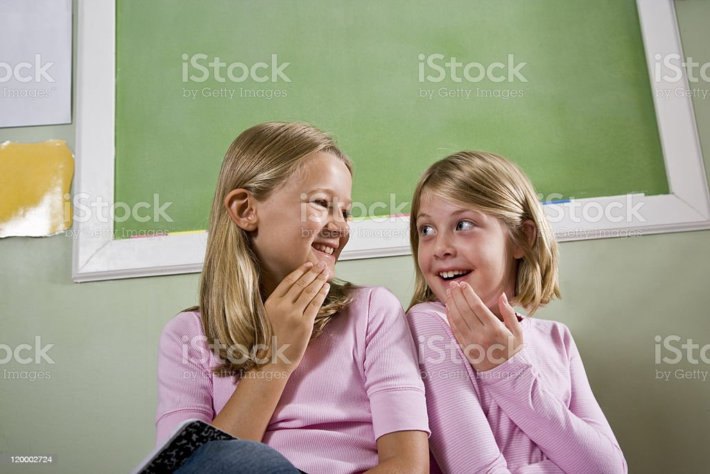 Friends in school classroom stock photo