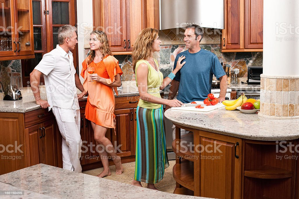 Friends in the Kitchen on Vacation royalty-free stock photo