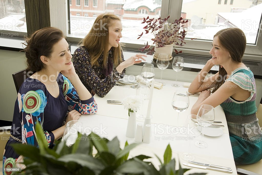 Friends in the restaurant royalty-free stock photo