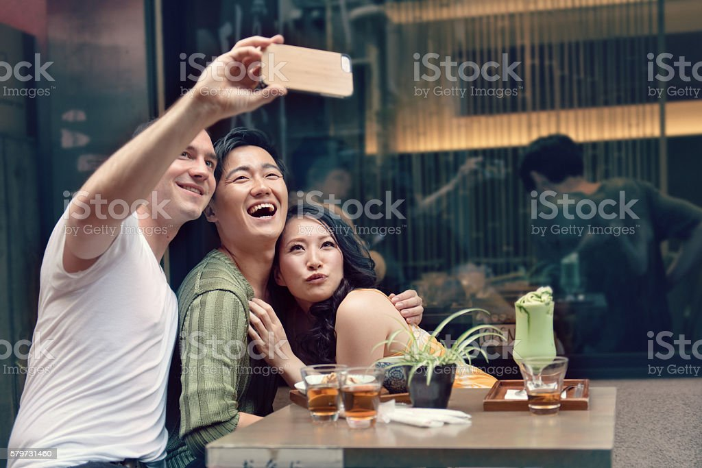 Friends in Tokyo taking selfie stock photo