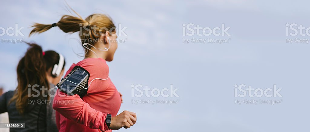 Friends jogging in the city stock photo