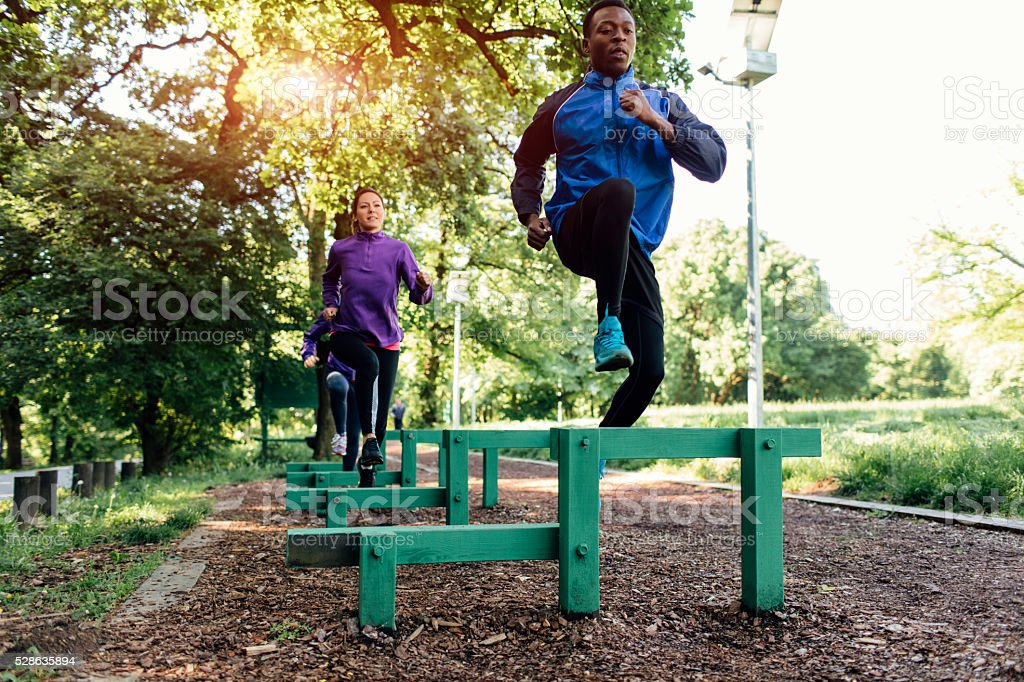 Friends jogging in the park. stock photo
