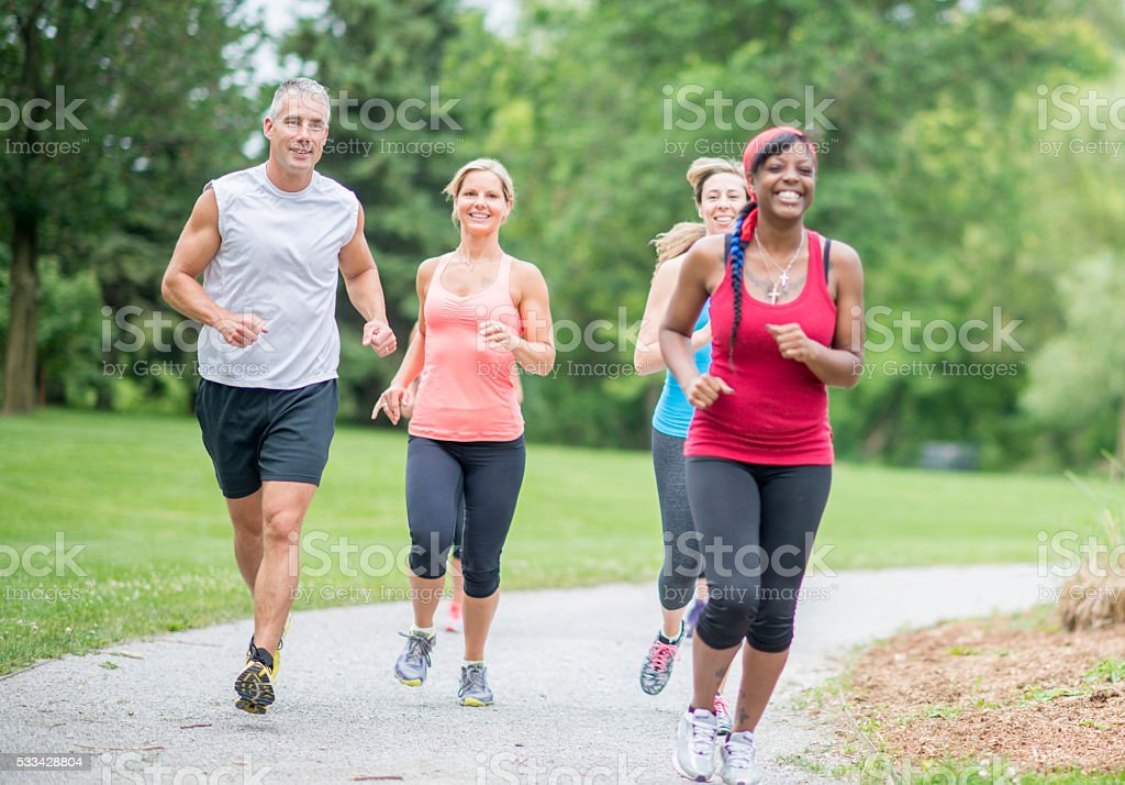 Friends Jogging in the Park stock photo