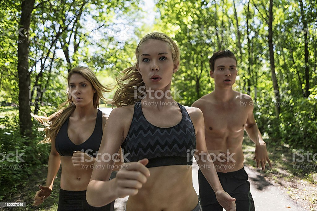 Friends Jogging On Road royalty-free stock photo