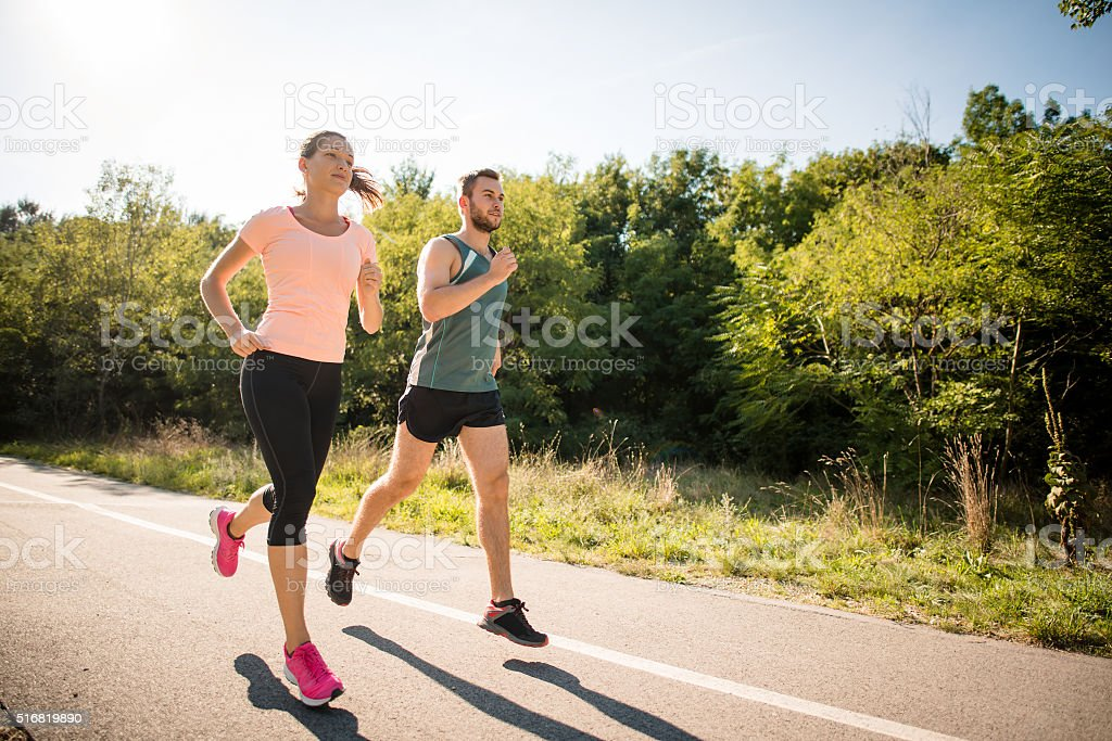 Friends jogging together stock photo
