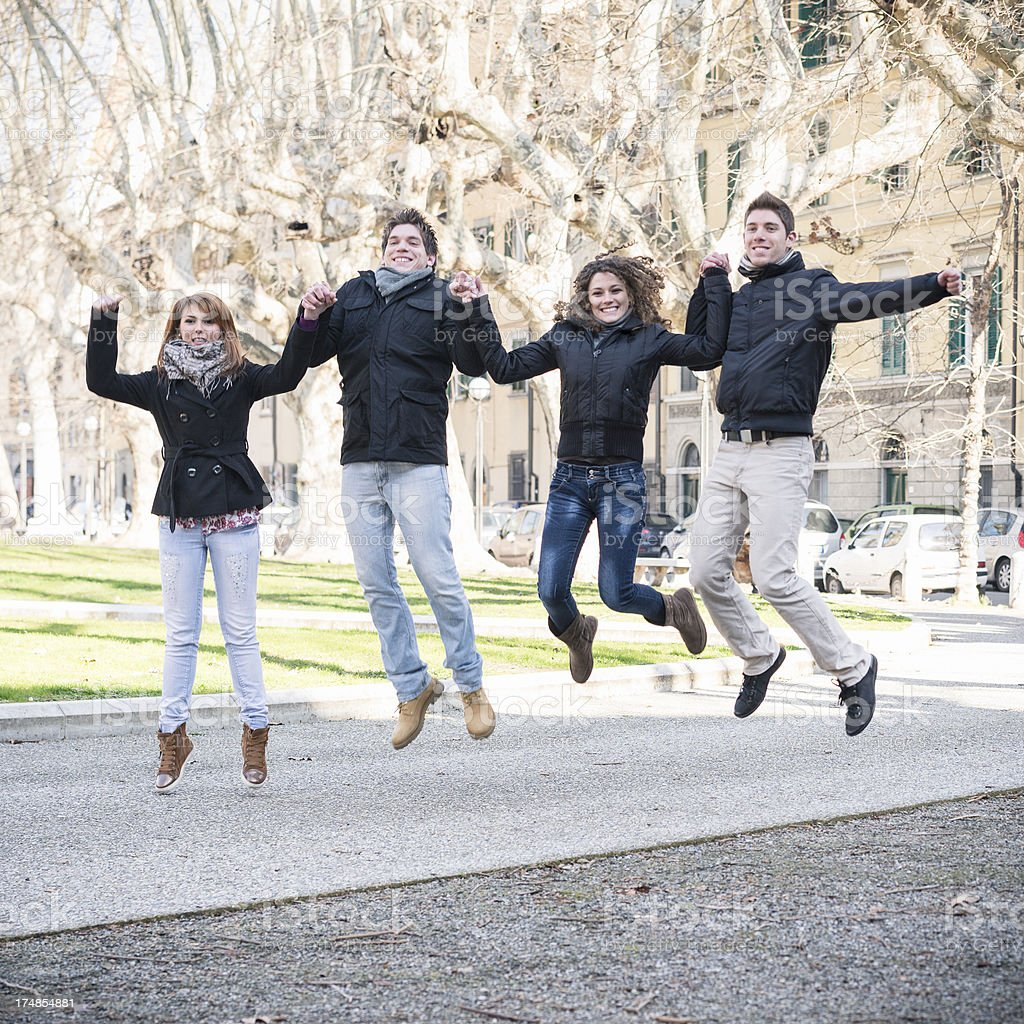 Friends jumping outdoors royalty-free stock photo