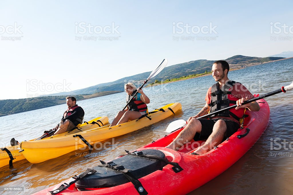 Friends kayaking in the mountains stock photo