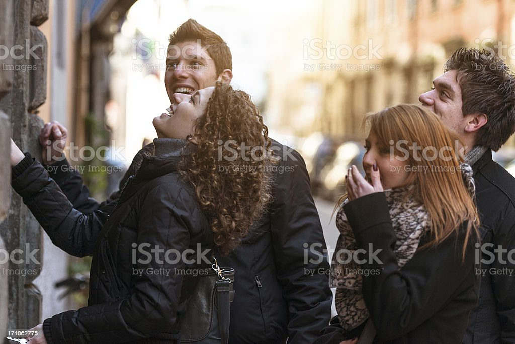 Friends knocking at the house door stock photo