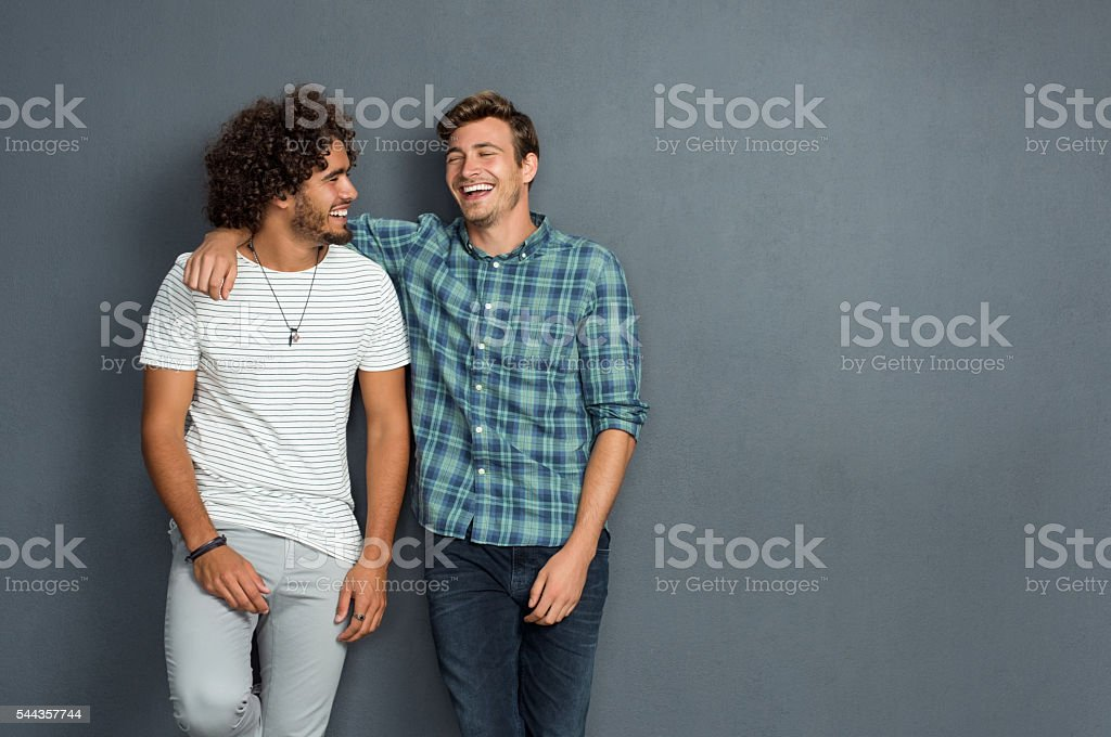 Friends laughing and enjoying stock photo