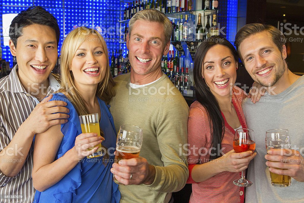 Friends Laughing in a Bar royalty-free stock photo