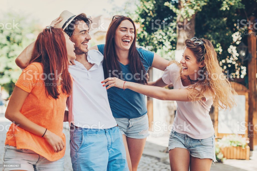 Friends laughing on the street stock photo