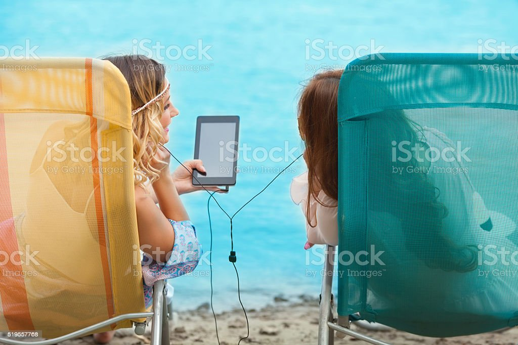 Friends Listening to Music stock photo