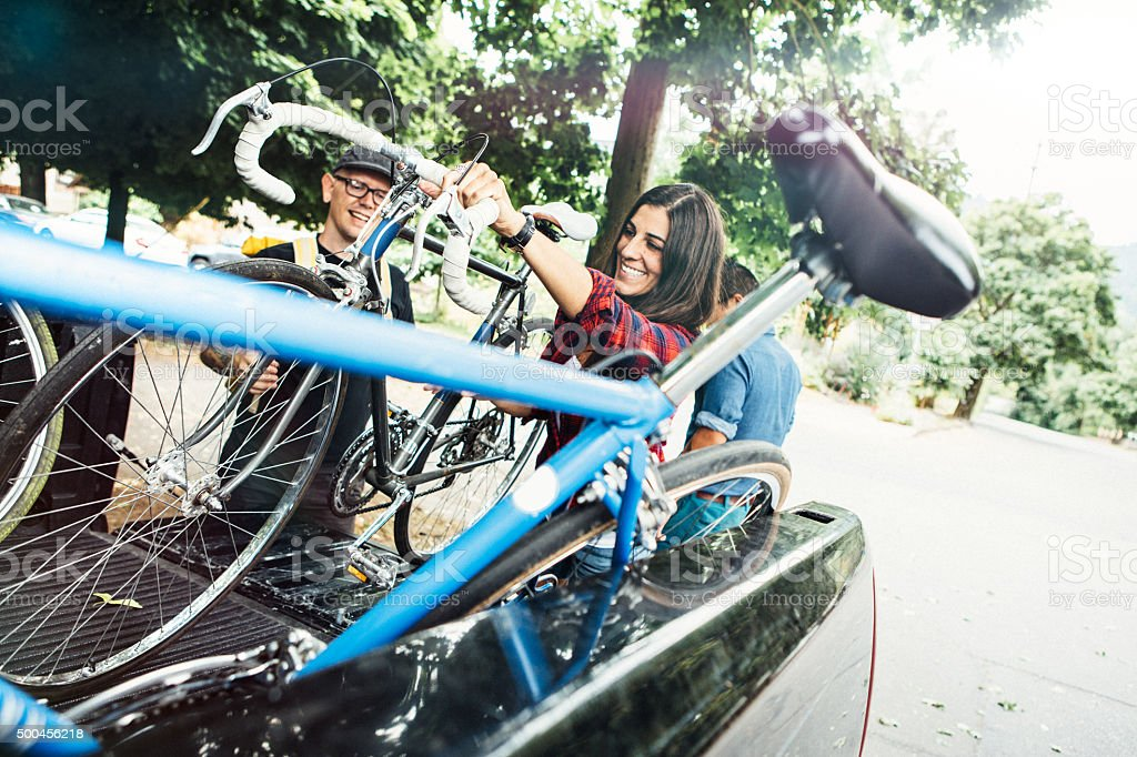 Friends Loading Their Bikes into Truck stock photo