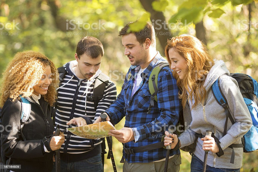 Friends looking at map on hiking. royalty-free stock photo