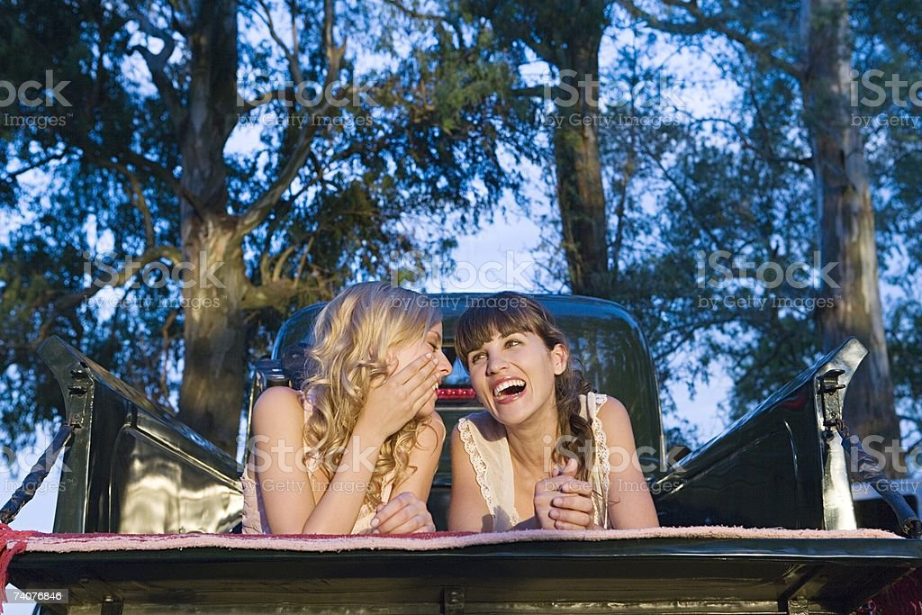 Friends lying on a pickup truck royalty-free stock photo