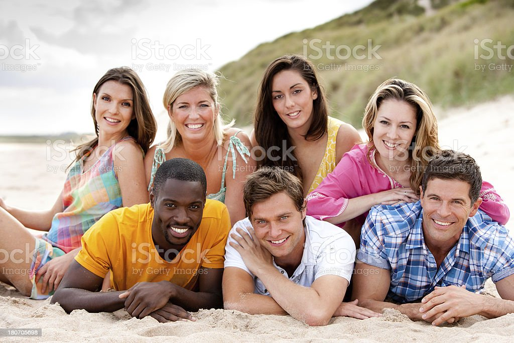 Friends Lying Together On The Beach royalty-free stock photo