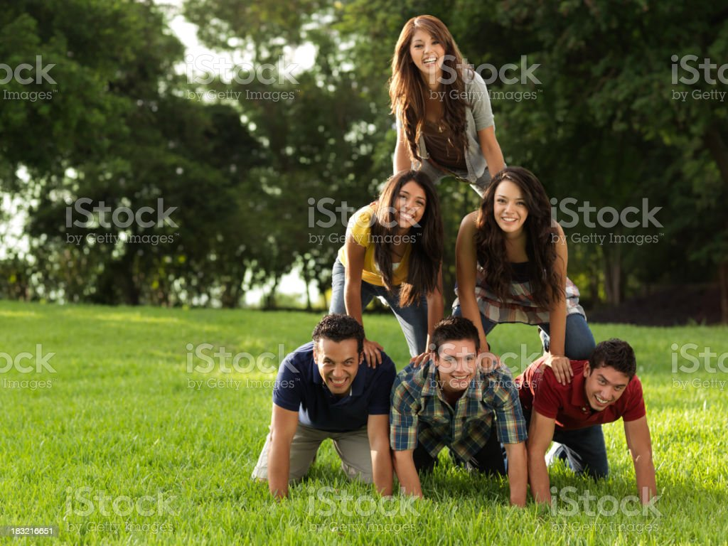 Friends making a human pyramid stock photo