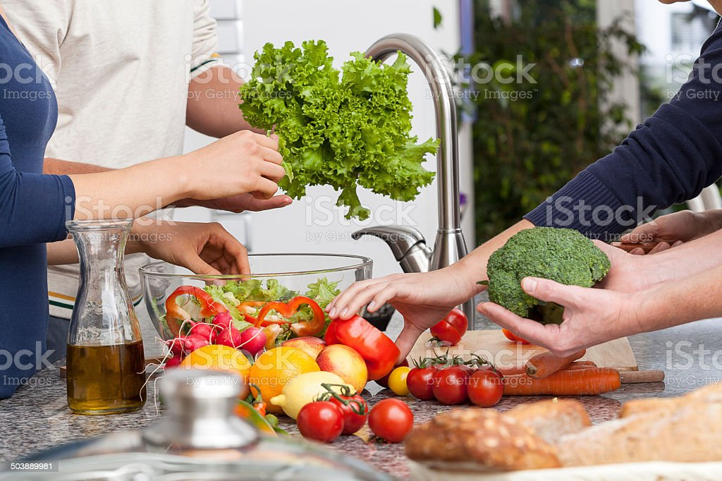 Friends making a salad stock photo