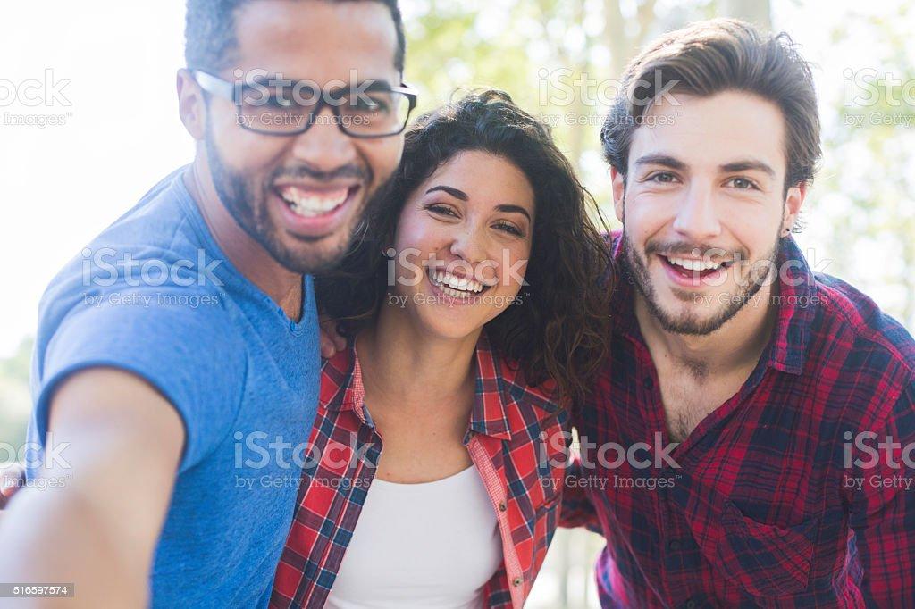 Friends making a selfie. stock photo