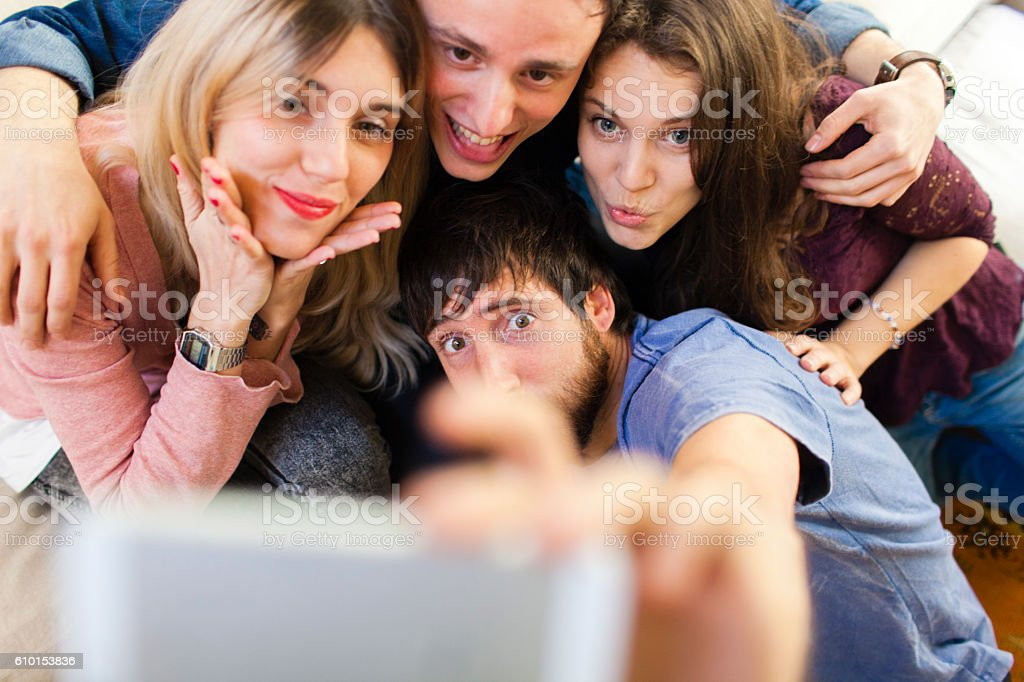 Friends making a selfie with a smartphone. stock photo
