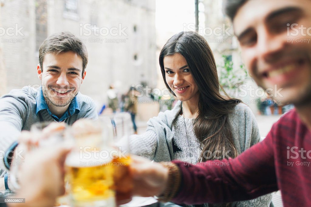 Friends making a toast in Barcelona. stock photo