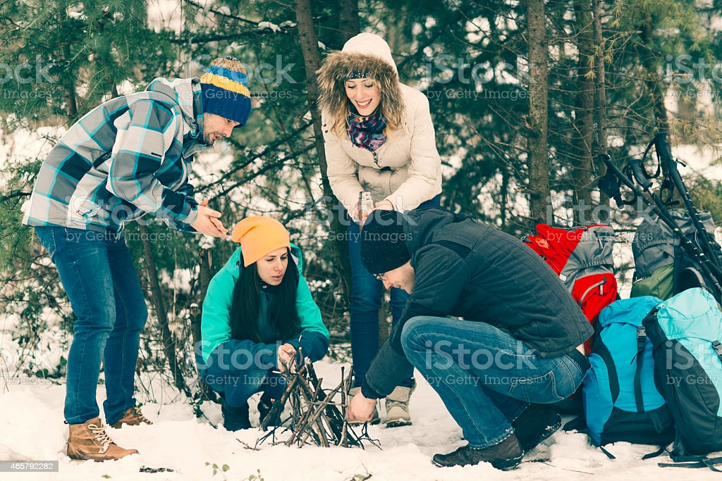 Friends Making Camp Fire. stock photo