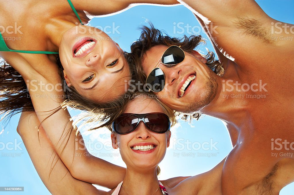 Friends making huddle royalty-free stock photo