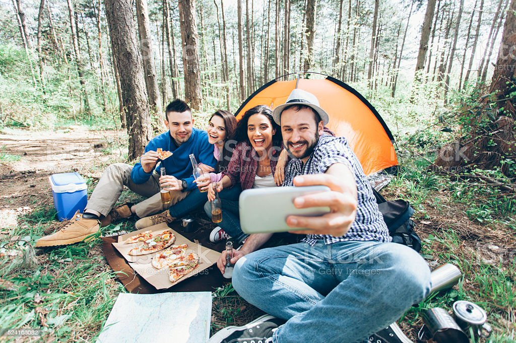 Friends making selfie at the forest stock photo