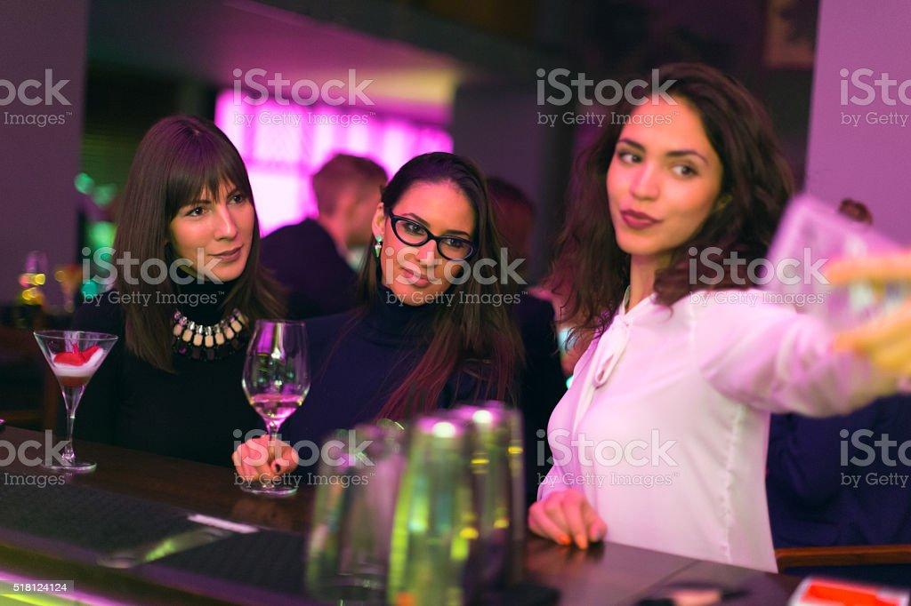 Friends making selfie in nightclub stock photo