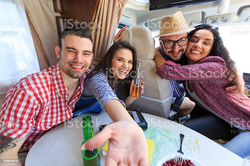 Friends making selfie inside of a caravan stock photo