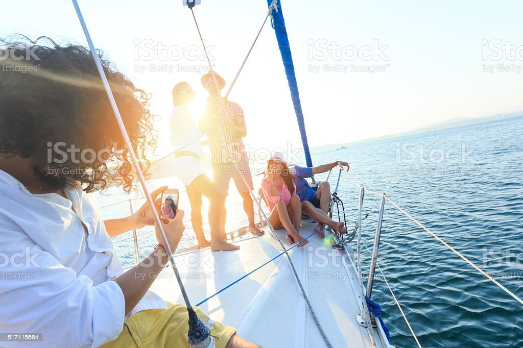 Friends making selfie on a sailboat stock photo