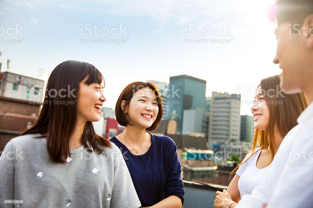 Friends meeting and party on Seoul rooftop, South Korea stock photo