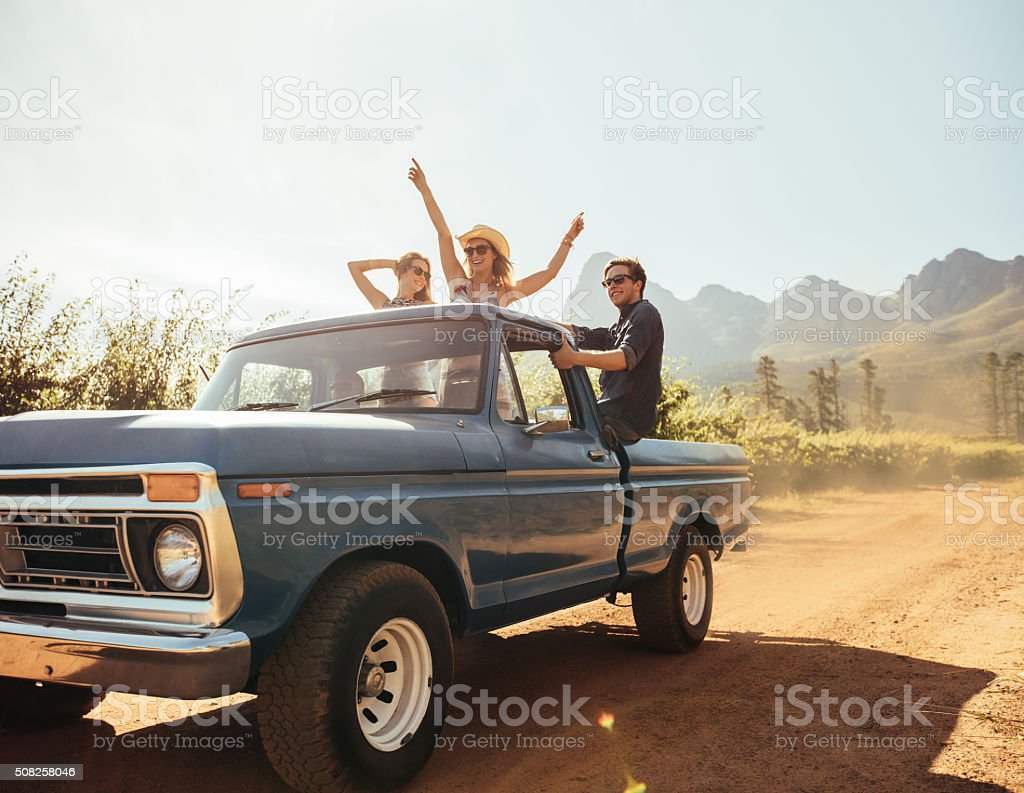 Friends on a pick up truck having fun stock photo