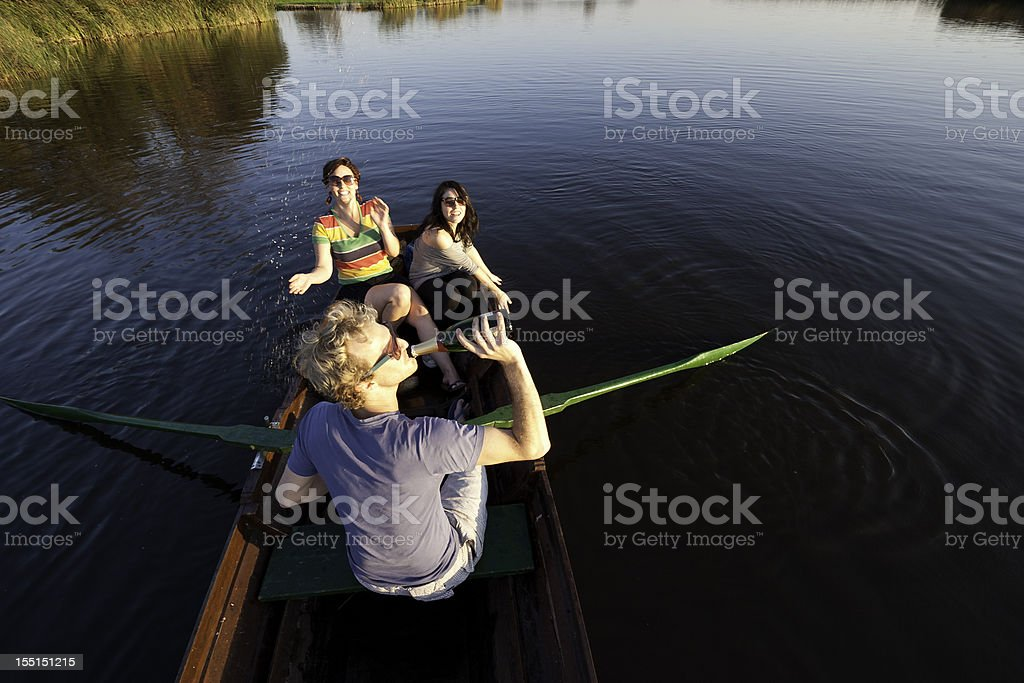 friends on a rowing boat royalty-free stock photo
