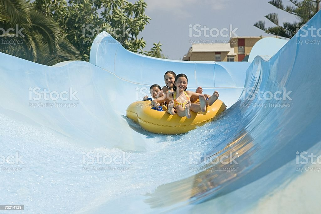 Friends on a water slide stock photo