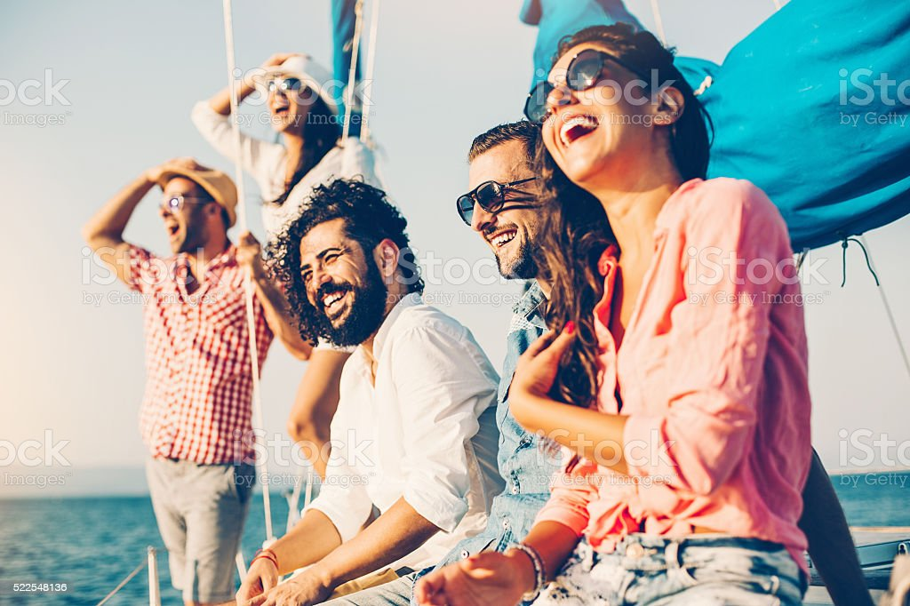 Friends on a yacht stock photo