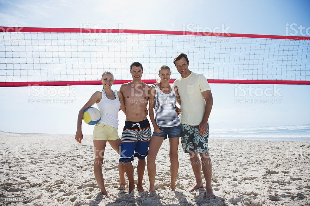Friends on beach volleyball court royalty-free stock photo
