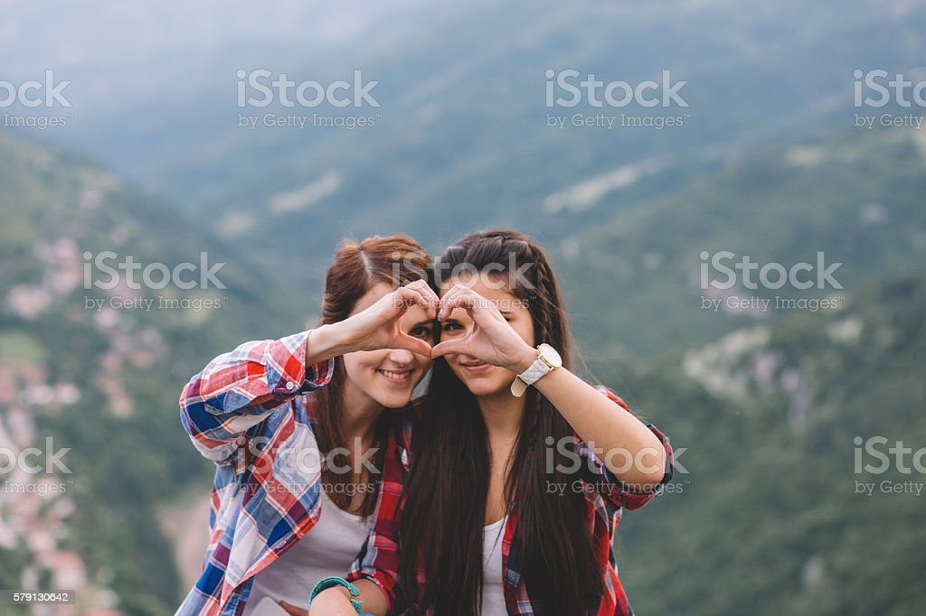 Friends on the mountain top stock photo