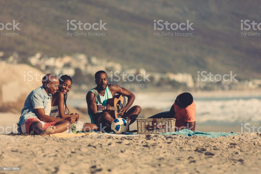 Friends on vacation relaxing at the beach stock photo
