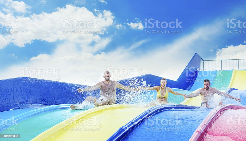friends on water slide royalty-free stock photo
