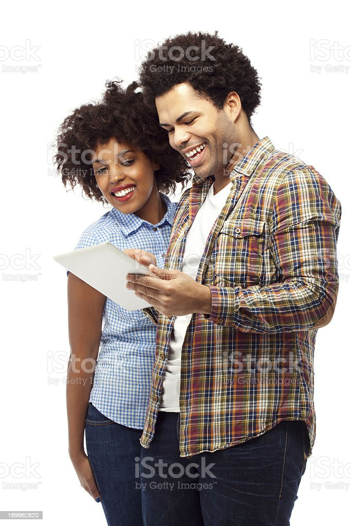 Friends or couple with digital tablet royalty-free stock photo