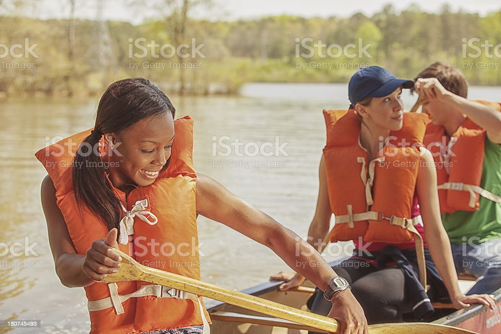 friends out on the canoe royalty-free stock photo