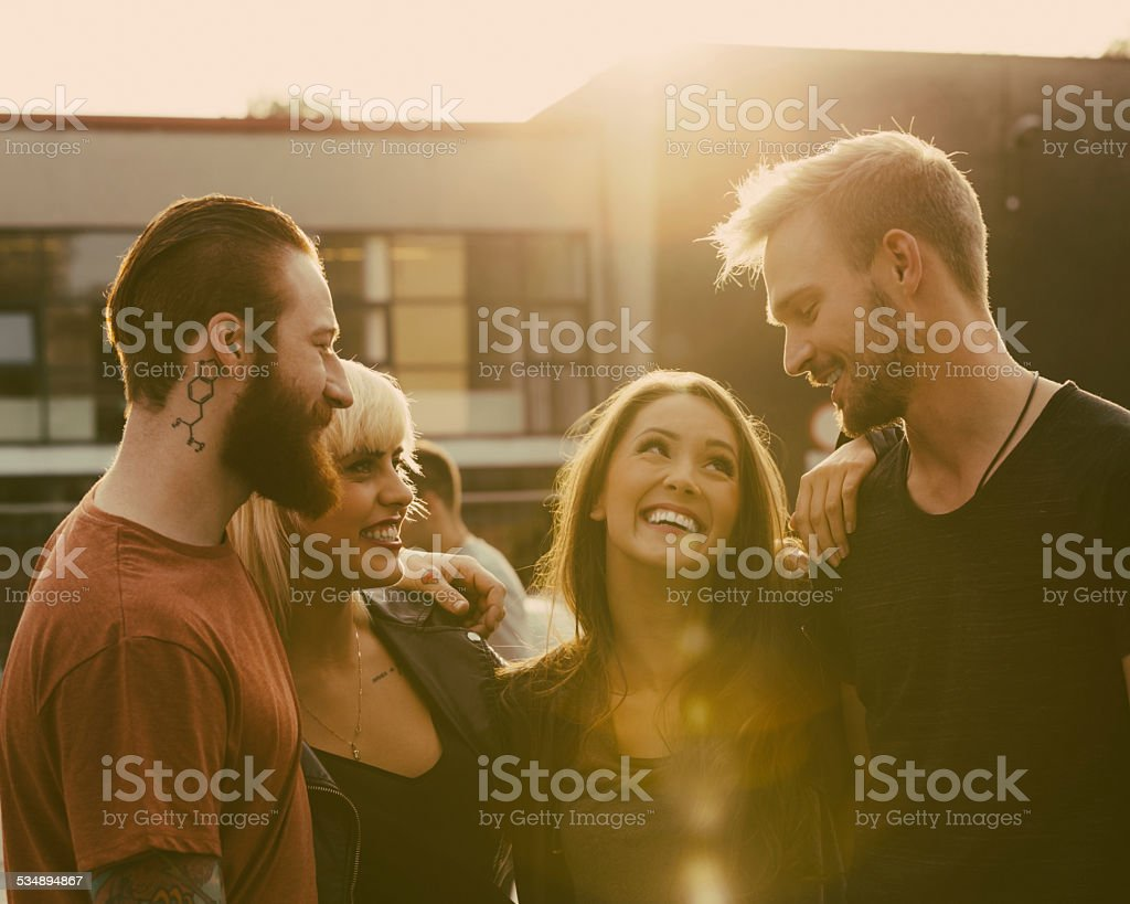Friends, outdoor portrait at sunset. stock photo