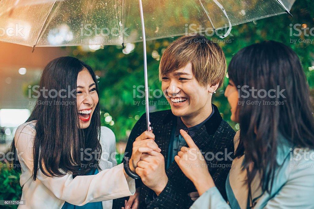 Friends outdoors at rainy night stock photo