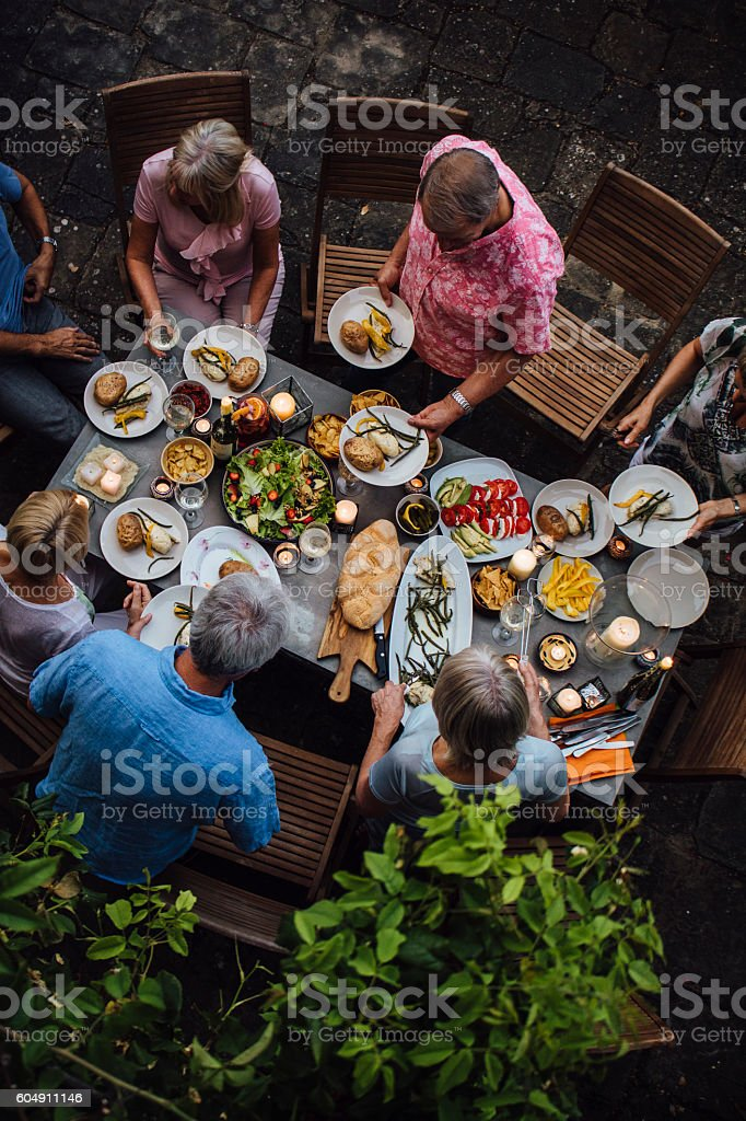 Friends Outdoors Dining stock photo