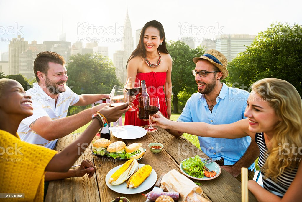 Friends Outdoors Party Celebration Hanging out Concept stock photo